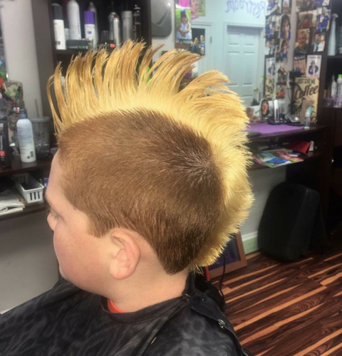Boy with a longer blonde mohawk